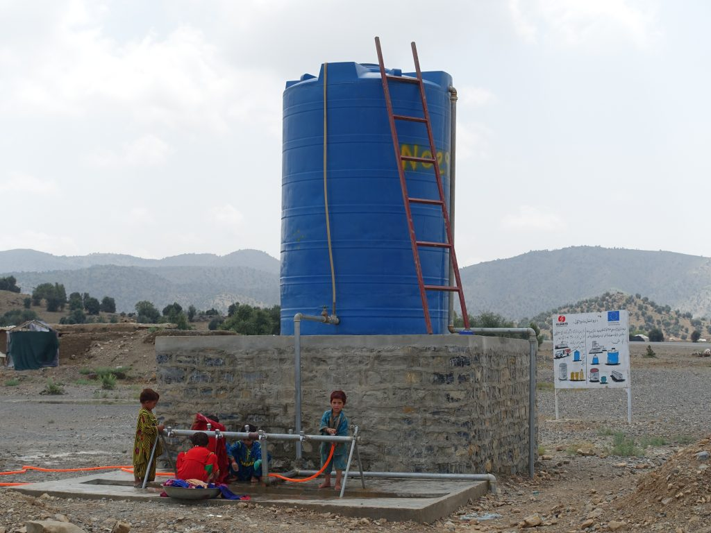 tank and solar panels afghanistan kids